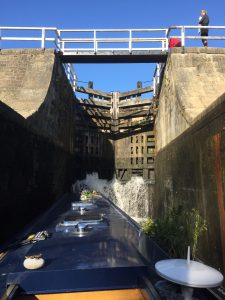 Narrowboat on the ascent of the Bingley Five Rise Locks